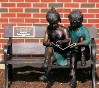 Children Statue Reading on a Bench Statue