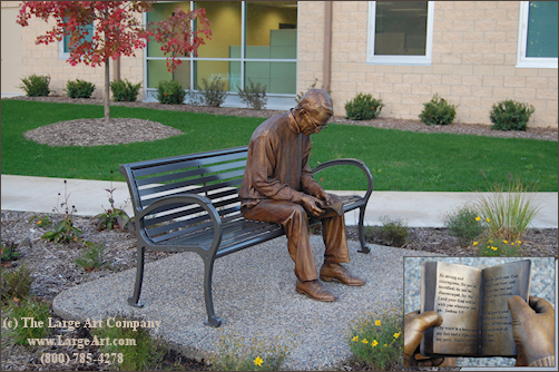 Public Art Sculpture of Man Reading Bible