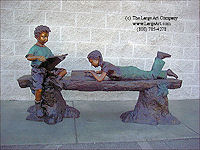 ../Boy & Girl Reading on a Log